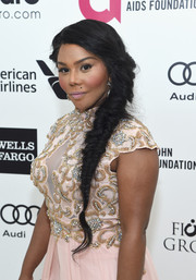 Lil Kim looked romantic with her side-swept fishtail braid at Elton John's Oscar-viewing party.