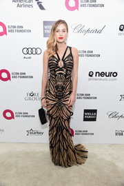 Dylan Penn rocked a bondage-glam vibe in a strappy, beaded nude and black gown by Zuhair Murad during Elton John's Oscar-viewing party.