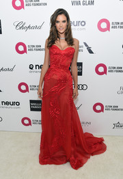 Alessandra Ambrosio was all about sweet glamour in a textured red strapless gown by Atelier Versace during Elton John's Oscar-viewing party.