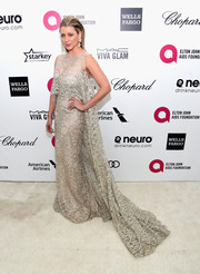 Lo Bosworth was a breathtaking sight to behold in a caped, web-patterned silver gown during Elton John's Oscar-viewing party.