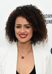 Nathalie Emmanuel framed her face with a thick curly 'do for the 2015 Elton John AIDS Foundation Oscar-viewing party.