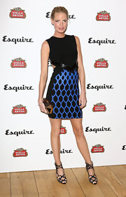 Caroline Winberg showed off just a touch of skin with this sleeveless black dress that featured a cool blue honeycomb print on the skirt.