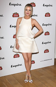 Laura Whitmore stunned in a sleeveless white bell-shaped frock.