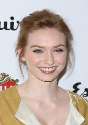 Eleanor Tomlinson pinned back her lovely strawberry locks into this pinned updo.