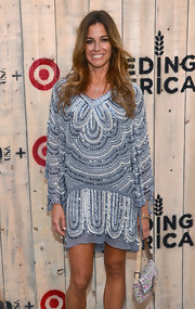 Kelly Bensimon looked vibrant in a blue shift dress with Art Deco-inspired beading at the Feed USA + Target launch.