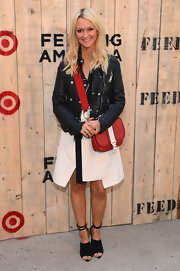 Zanna Roberts-Rassi was edgy-chic in a black leather motorcycle jacket and an asymmetrical-hem skirt at the Feed USA + Target launch.