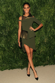 Joan Smalls oozed an ultra-modern vibe at the Fashion Fund finalists celebration in an olive-green Prabal Gurung dress with an asymmetrical hem and sleeves and peplum detailing.