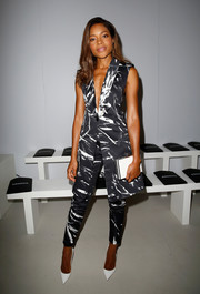 Naomie Harris completed her white accessories with a classic box clutch.
