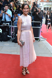 Pippa Middleton complemented her pink outfit with a pair of gold strappy sandals.