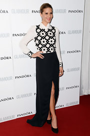 Amanda Byram stuck with a mod-style black-and-white look with this long-sleeve embellished blouse and black skirt.
