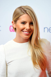 Mollie King wore her long hair straight and swept to the side when she attended the Glamour Women of the Year Awards.