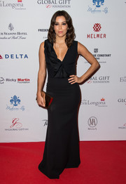 Eva Longoria went for understated glamour at the Global Gift Gala in a sleeveless black Victoria Beckham gown with a ruffle-accented bodice.