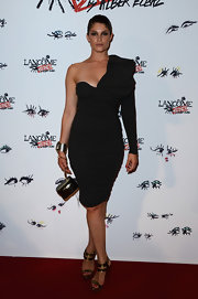 Gemma Arterton showed off some killer curves with this fitted one-sleeve dress with a bold shoulder ruffle.