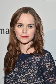Taryn Manning complemented her lace dress with a long curly 'do for a totally feminine look during the Life is Love Gala.