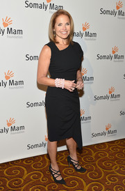 Katie Couric sported a modern vibe at the Life is Love Gala in an asymmetrical navy dress.