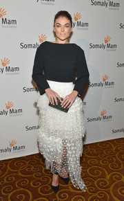 Serinda Swan played with contrasts at the Life is Love Gala, pairing an ultra-girly tiered white skirt with a plain black top.