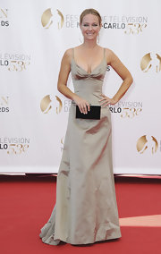 Sharon Case kept it simple and sophisticated with a light tan floor-length gown.