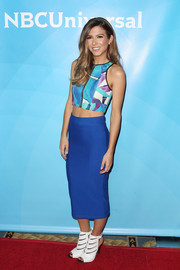 Orly Shani completed her vibrant look with an electric-blue pencil skirt.