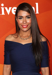 Daniella Alonso wore her long, straight hair loose with a deep side part during NBCUniversal's Summer Press Day.