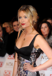 Soft face-framing strands put a pretty spin on Laura Whitmore's loose updo at England's National Television Awards.