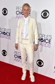 Ellen DeGeneres debuted her very own design on the People's Choice Awards red carpet: a sporty cream-colored pantsuit that she teamed with a Saint Laurent button-down.