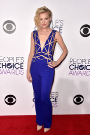 Portia de Rossi was all about modern sleekness at the People's Choice Awards in a cobalt Zuhair Murad jumpsuit with a geometric-patterned bodice.