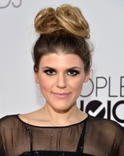 Molly Tarlov turned heads with her voluminous top-knot at the People's Choice Awards.