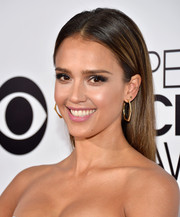 Jessica Alba complemented her hairstyle with a pair of gold hoops by Jennifer Meyer.