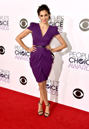 Daniela Ruah struck a pose on the People's Choice Awards red carpet wearing a purple cocktail dress with a draped skirt.
