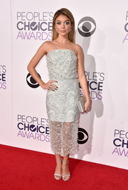 Sarah Hyland polished off her red carpet look with a Jill Milan box clutch, also in silver.