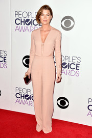 Ellen Pompeo went for minimalist sophistication in a lace-accented nude jumpsuit by Elie Saab at the People's Choice Awards.