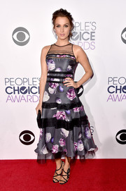 Camilla Luddington amped up the girly appeal with a pair of black strappy sandals.