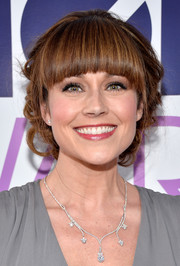Nikki Deloach wore her hair in pinned-up ringlets with youthful blunt bangs during the People's Choice Awards.