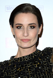 Erin O'Connor was fresh-faced at the pre-BAFTA party wearing this short side-parted 'do.