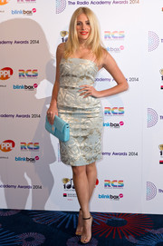 Pixie Lott accessorized with a Fendi quilted clutch in a cool turquoise hue.