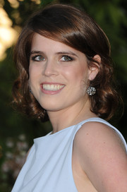 Princess Eugenie topped off her look with a sweet side-parted curly 'do during the Serpentine Gallery Summer Party.