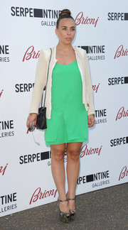 Chloe Green kept it simple in a white cardigan layered over a bright green mini during the Serpentine Gallery Summer Party.