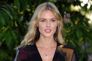 Donna Air wore her hair in subtle waves with a center part during the Serpentine Gallery Summer Party.