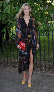 Donna Air kept it classy and conservative (well, except for that crotch-grazing slit) in a long-sleeve print dress during the Serpentine Gallery Summer Party.
