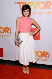 Krysta Rodriguez completed her hip red carpet look with a colorful beaded clutch.