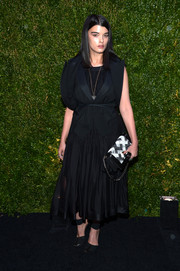 Crystal Renn looked subdued in this black-on-black  LBD and waistcoat combo at the Tribeca Film Festival Artists Dinner.