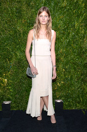 Constance Jablonski looked very girly in a white Chanel fishtail dress during the Tribeca Film Festival Artists Dinner.