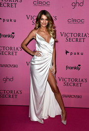 Bregje Heinen put her cleavage and legs on display in a draped white wrap gown during the Victoria's Secret fashion show after-party.