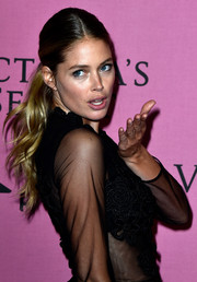Doutzen Kroes was fresh-faced with her hair slicked back into a wavy ponytail at the Victoria's Secret fashion show after-party.