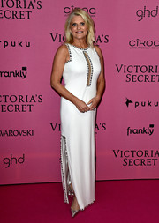 Sharen Turney hit the Victoria's Secret after-party wearing an embellished white evening dress with a sheer panel down the bodice.