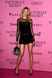 Sigrid Agren went for a leggy look in a tiny lace LBD during the Victoria's Secret fashion show after-party.