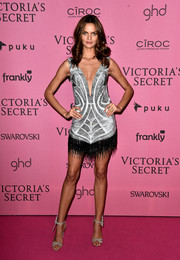 Barbara Fialho went for a sexy-flapper-girl look in a beaded silver mini dress with a black fringed hem and a deep-V neckline during the Victoria's Secret fashion show after-party.