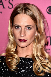 Poppy Delevingne injected a spot of bold color via dark red lipstick.