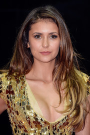 Nina Dobrev wore her hair loose with piecey layers when she attended the World Music Awards.
