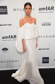 Lily Aldridge looked dramatic in an elegant white off-the-shoulder blouse by Rosie Assoulin during the amfAR New York Gala.